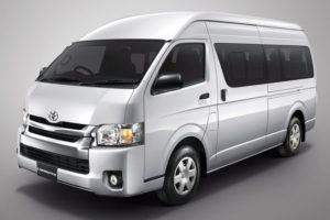 photo of front three-quarter view of Silver Toyota Commuter mini van, for rent